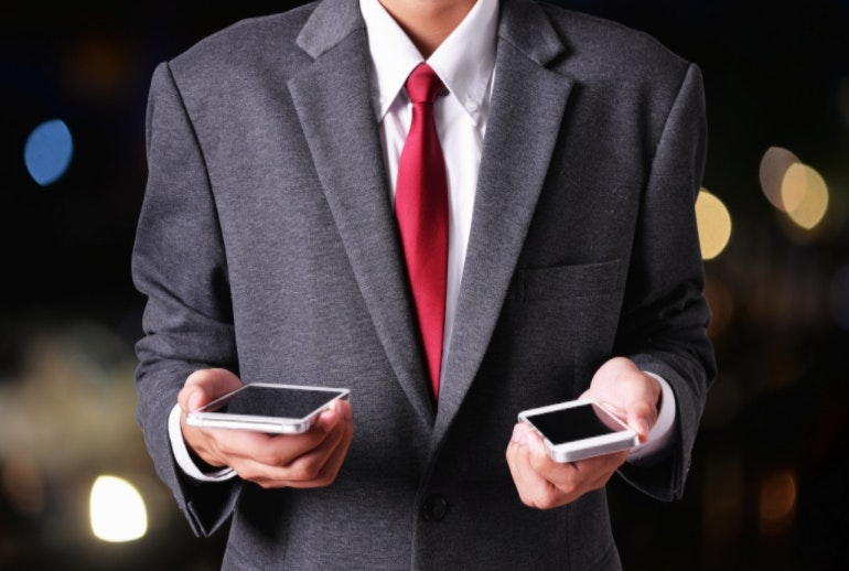 Man holding two phones data transfer